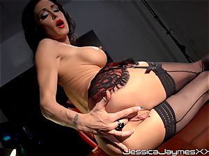 ultra-kinky brunette Jessica Jaymes fingers her delicious coochie pie in her office