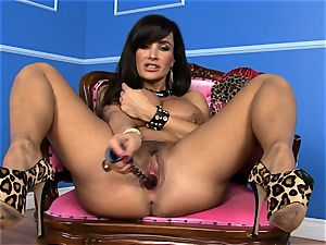 magnificent Lisa Ann tucks her faux-cock deep in her humid vagina