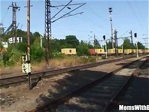 elder brown-haired dame bang Along The train Tracks