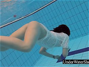 fabulous ginger-haired in the white dress underwater