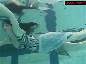 Blackhaired ultra-cutie Irina underwater