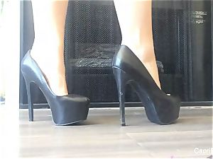 Capri demonstrates off her wonderful soles & tries on some high-heeled slippers