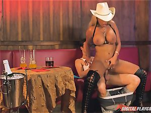 Bridgette B in steamy leather boots and porks on a couch